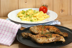 Potato salad. With some organic chicken drumsticks stock images