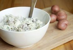 Potato Salad. Red skinned potato salad in bowl royalty free stock photography