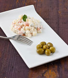 Potato salad. With mayonaise sauce and olives stock photography