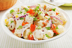Potato Salad. A bowl of potato salad with creamy mustard dressing. Salad also includes orange and yellow peppers, red onions and stuffed olives royalty free stock photography