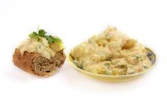Potato salad. Dish of potato salad and sandwich on white backround stock photo
