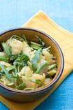 Potato salad with avocado and arugula Stock Photos