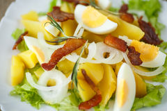 Potato salad with bacon and eggs Stock Photo