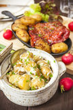 Potato salad and bacon rib with roasted potatoes. Farmhouse styl Royalty Free Stock Image
