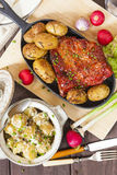 Potato salad and bacon rib with roasted potatoes. Farmhouse styl Royalty Free Stock Photo