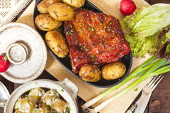 Potato salad and bacon rib with roasted potatoes. Farmhouse styl Royalty Free Stock Image