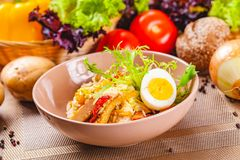 Potato salad with chicken and bacon in beige bowl. Close up stock photos