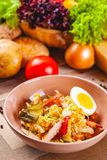 Potato salad with chicken and bacon in beige bowl. Close up royalty free stock images