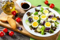 Potato salad with chicken eggs, leaves oakleaf lettuce, cheese, Royalty Free Stock Photography