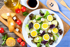 Potato salad with chicken eggs, leaves oakleaf lettuce, cheese, Royalty Free Stock Images