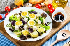 Potato salad with chicken eggs, leaves oakleaf lettuce, cheese, Stock Photo