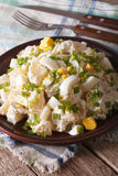 Potato salad with chives and egg close-up on a plate. Vertical Royalty Free Stock Image