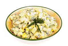 Potato Salad. Delicious Freshly Made Creamy Potato Salad in Beige Rustic Bowl isolated on white background royalty free stock photos