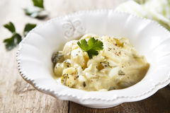 Potato salad. With eggs and gherkins royalty free stock photo