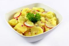 Potato salad. Fresh potato salad with garden radish, parsley and chives Royalty Free Stock Photography