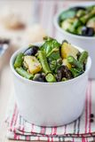 Potato salad with green beans, olives, capers, onions, delicious Stock Photo