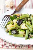 Potato salad with green beans, olives, capers, onions, delicious Royalty Free Stock Photo