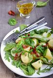 Potato salad with green beans and sun-dried tomatoes. In plate Stock Images