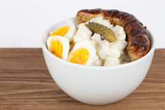 Potato salad with grilled sausage royalty free stock images