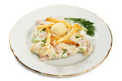 Potato salad, ham, cucumber and eggs on plate Stock Photos