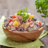 Potato salad with ham, mushroom, pepper, olive, crab Royalty Free Stock Photo