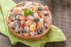 Potato salad with ham, mushroom, pepper, olive, crab Royalty Free Stock Photography
