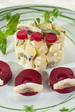 Potato salad with herring and beets. Delicious and nutritious potato salad with herring and beets Stock Photos