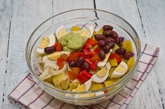 Potato Salad. Ingredients for Potato Salad in a glass bowl, just before being mixed together (potatoes, eggs, avocado mayonnaise, onion, kalamata olives, pepper Royalty Free Stock Photography