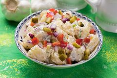 Potato salad with mayonnaise dressing. Potato salad with pickles, onion and mayonnaise dressing stock photos