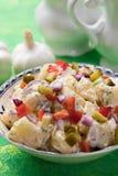 Potato salad with mayonnaise dressing. Potato salad with pickles, onion and mayonnaise dressing royalty free stock photos