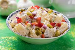 Potato salad with mayonnaise dressing. Potato salad with pickles, onion and mayonnaise dressing royalty free stock photography