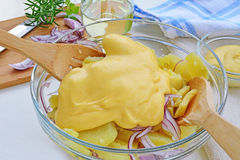 Potato salad with mayonnaise preparation Royalty Free Stock Images