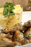 Potato salad with organic chicken drumsticks Stock Photo