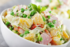 Potato salad with peas and ham. And mayonnaise dressing stock photo