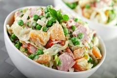 Potato salad with peas Stock Image