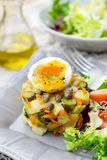 Potato salad with pickles, carrots and soft-boiled egg Royalty Free Stock Image