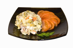 Potato salad on a plate. Isolated Stock Photo