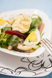 Potato salad with red beet, smoked herring, egg and soy-bean mayonnaise. Close-up photo Stock Photo