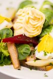 Potato salad with red beet, smoked herring, egg and soy-bean mayonnaise. Close-up photo Royalty Free Stock Photos