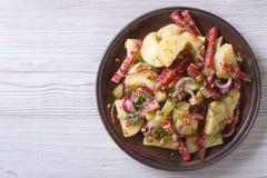 Potato salad with salami top view horizontal Royalty Free Stock Image