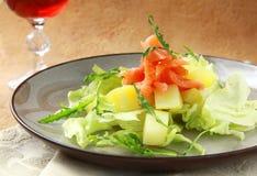 Potato salad with smoked salmon and arugula Royalty Free Stock Images