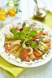 Potato salad with smoked sea bass and salmon Stock Photo