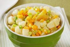 Potato Salad. With sweet potato, sweetcorn and garlic shoots in a dill mayonnaise stock image