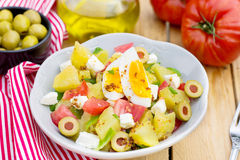 Potato salad with tomato, bell pepper, feta cheese and eggs Royalty Free Stock Images