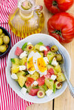 Potato salad with tomato, bell pepper, feta cheese and eggs Royalty Free Stock Image