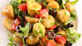 Potato salad. With tomato and olive royalty free stock image