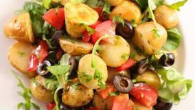 Potato salad. With tomato and olive stock photo