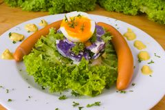 Potato salad with Wiener. Colorful potato salad with egg and sausages royalty free stock photography