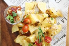 Potato salad on wooden plate. In close up royalty free stock photos
