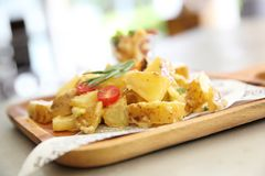 Potato salad on wooden plate. In close up royalty free stock image